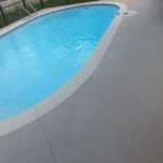 Pool deck after cleaning and staining